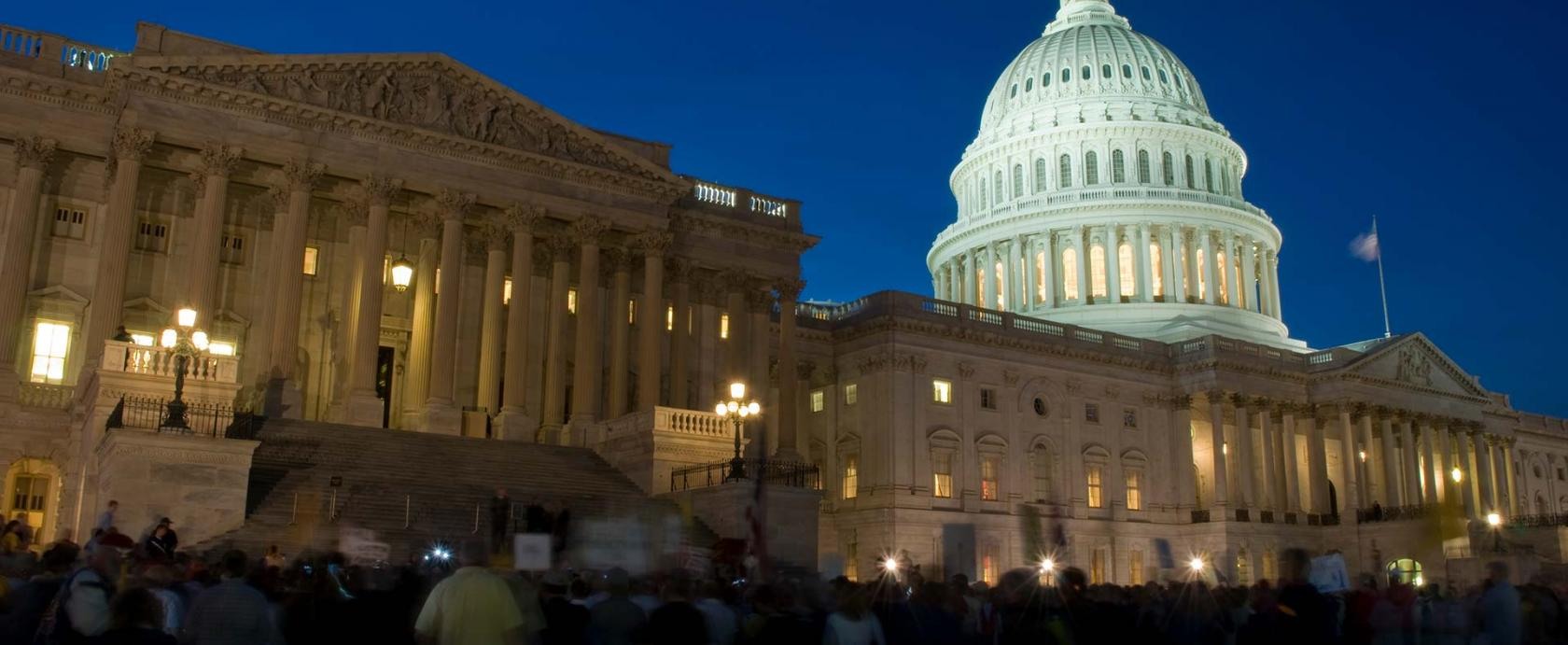 The U.S. Capitol Building at Night - Crowd of People Outside