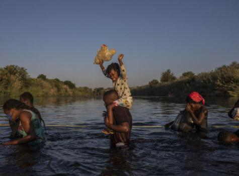 Haitians crossing the border
