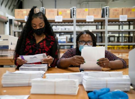 Black Female Election Workers - tallying election votes