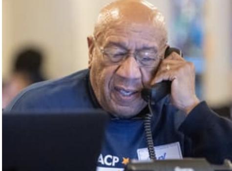 An NAACP volunteer calling voters