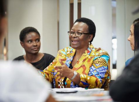 Black Female Speaking in Meeting