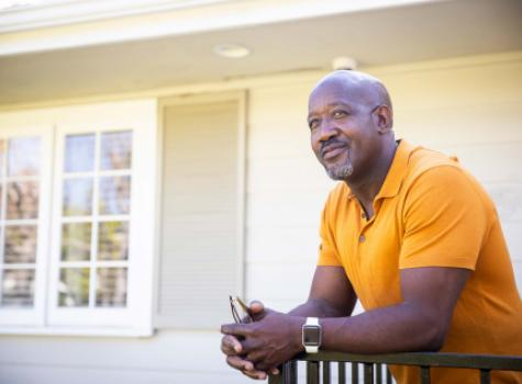 Black Male in Front of House Smiling