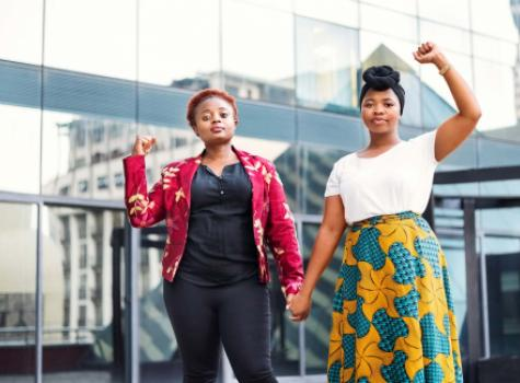 Young Black Females - Outdoors - Holding Hands and Raising Fists