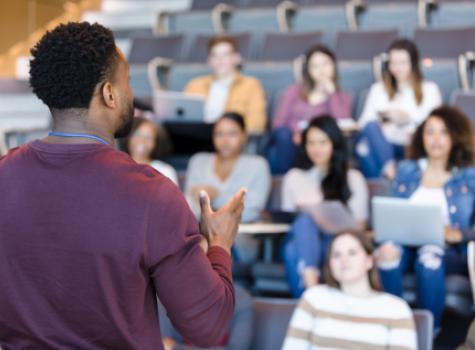 Black Man Teaching a Classroom of Students