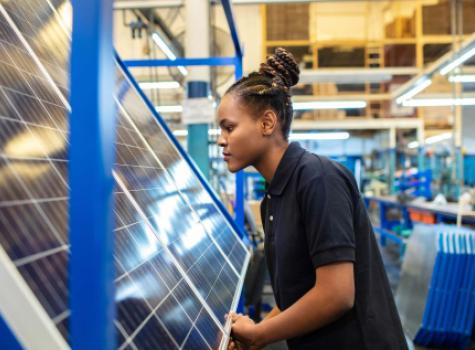 Black Female - Solo - in factory work environment