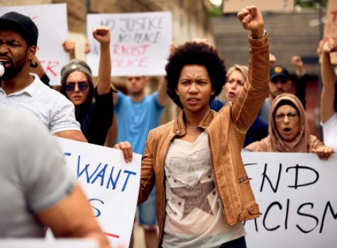 Black Female in Protest with Raised Fist