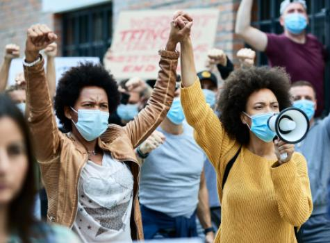 Black Females with Hands Locked in Protest