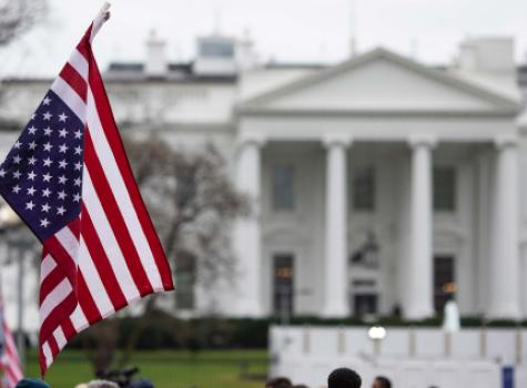 American Flag Hanging Outside of the White House