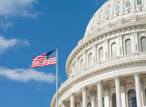 Close-up - The U.S. Capitol Building with American Flag - Daylight